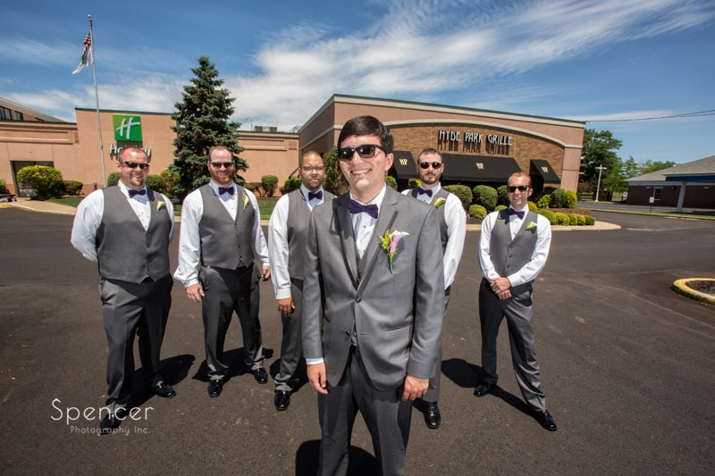 dramatic picture of groomsmen outside akron hotel