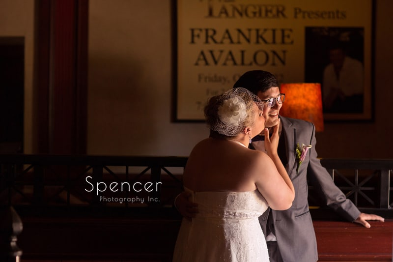 bride kissing groom before wedding at tangier akron