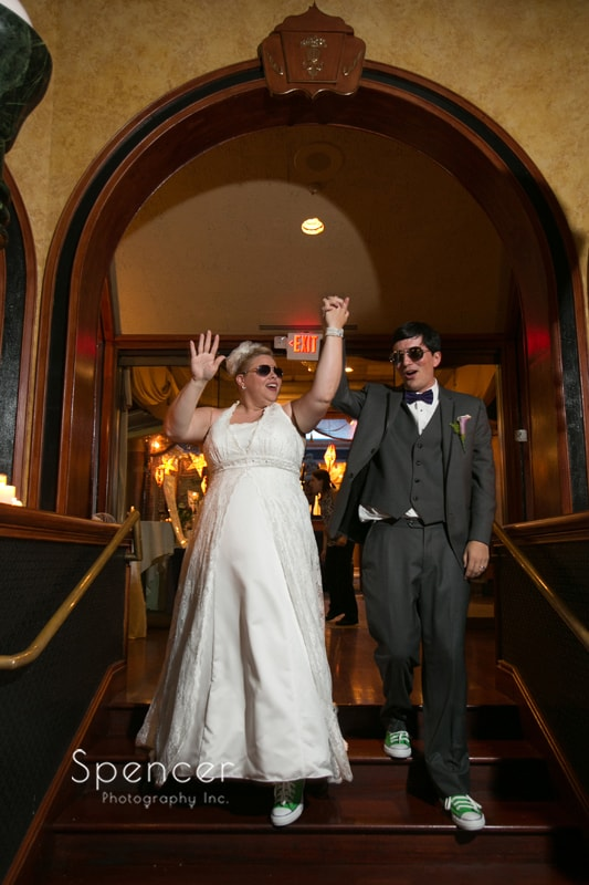 bride and groom entering their wedding reception at akron tangier