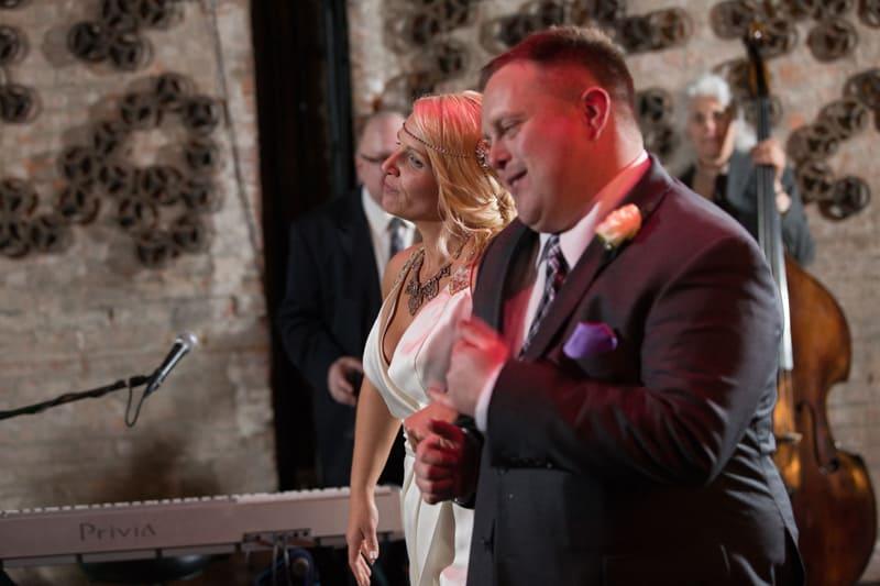 bride and groom dancing at reception at metropolitan