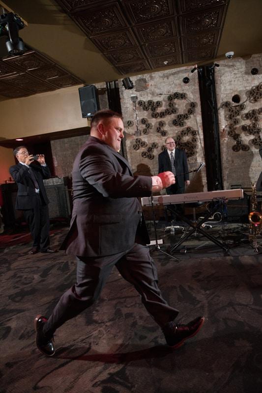 groom dancing at his wedding reception at metropoltian