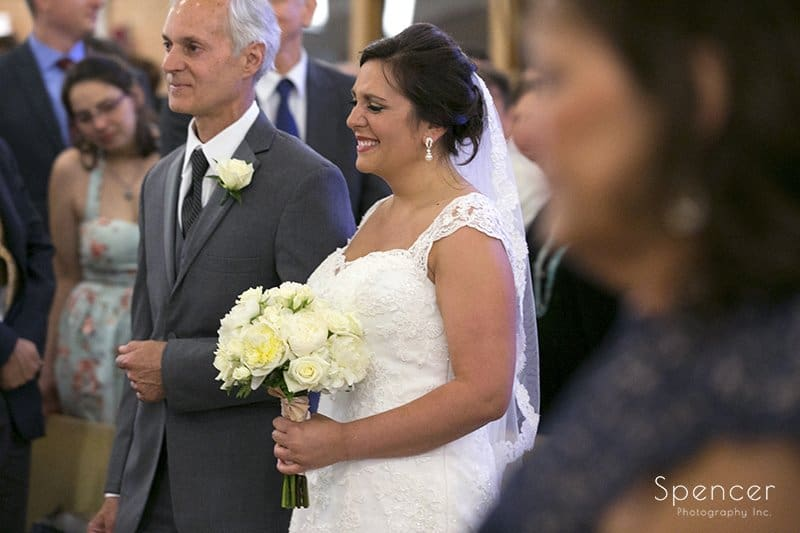 bride walking down aisle with with dad at Holy Family church