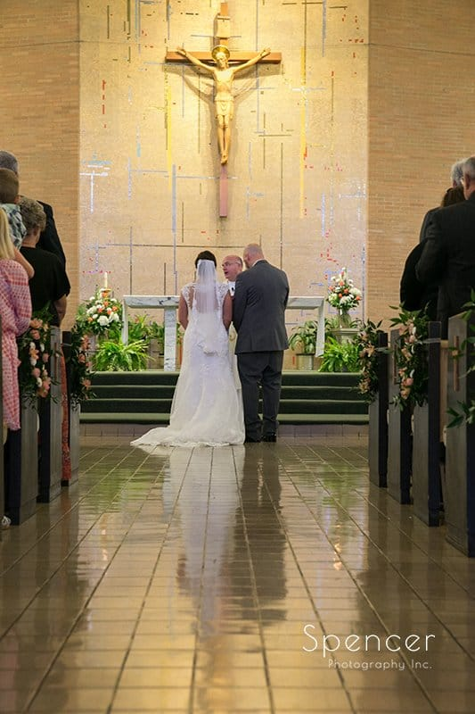 bride and groom at altar during wedding ceremony at Holy Family Church