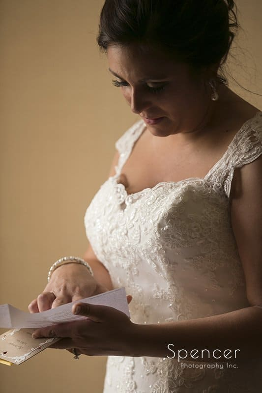 bride reads wedding day note from groom
