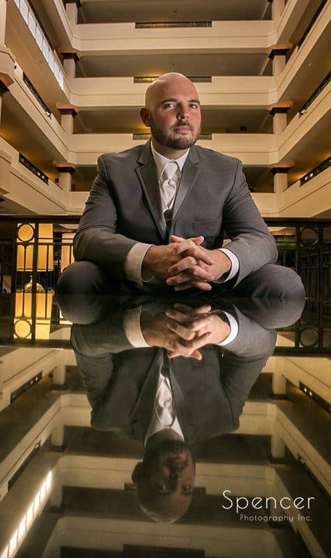 creative wedding picture of groom at Sheraton Suites Cuyahoga Falls