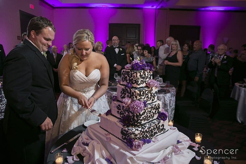 bride and groom cutting cake at bertam inn wedding reception