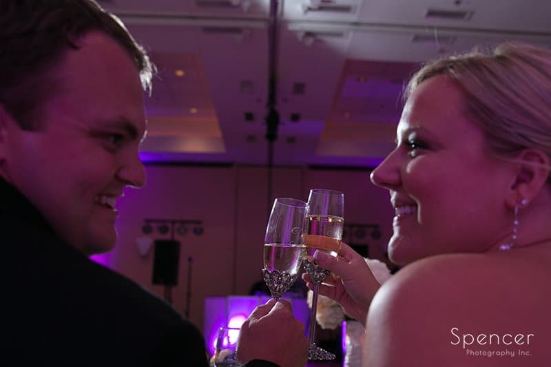 bride and groom toast at wedding reception at Bertram Conference Center