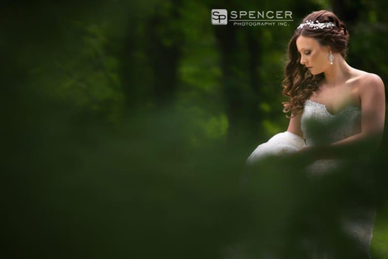 bride posing in woods