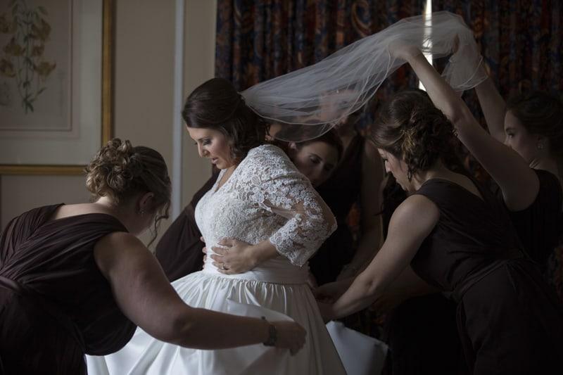 bride putting on wedding dress at cleveland union club