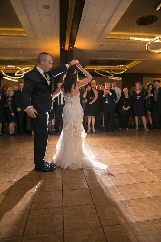 groom spins bride at westin wedding reception
