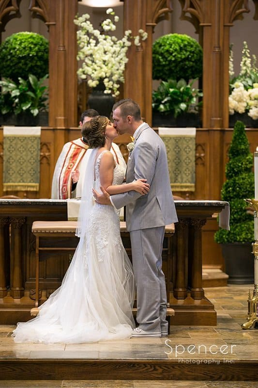 first kiss at wedding Ceremony at St. Mary's Catholic Church