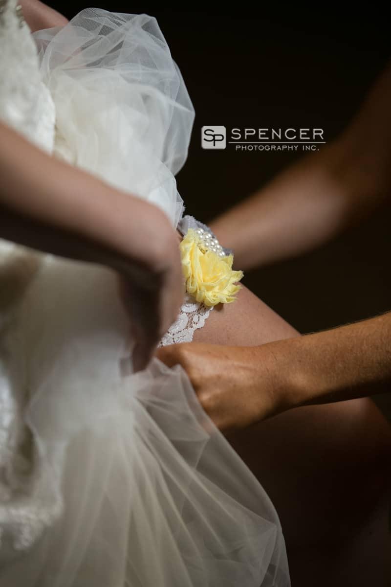 bride putting on wedding garter