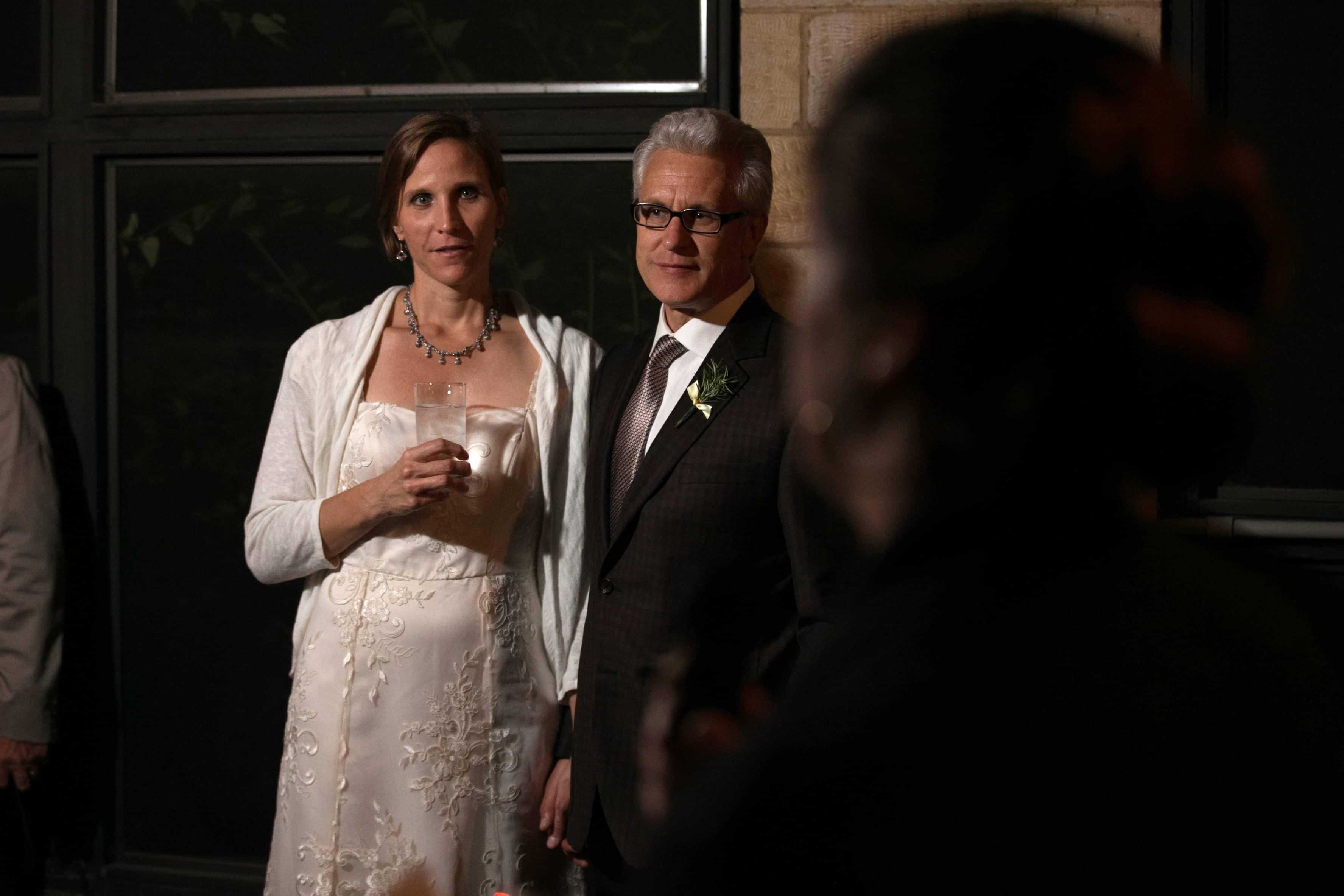 bride and groom listening to speech