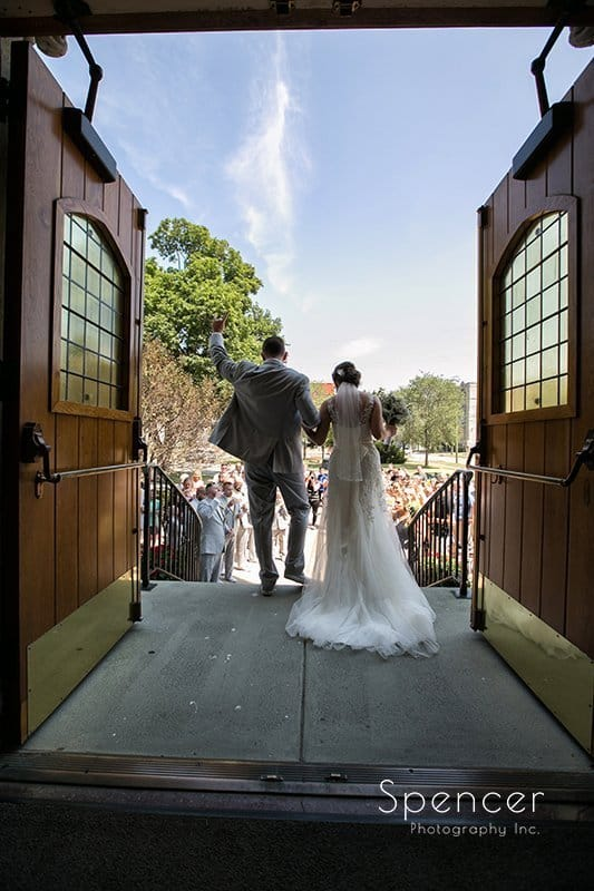 bride and groom exit their wedding at St. Mary's in Sandusky