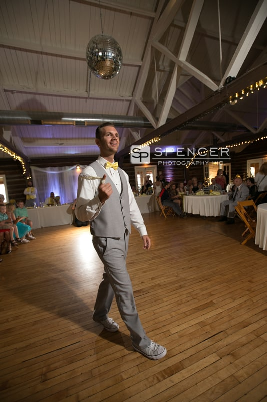 groom throwing garter at vermilion on the lake weddging reception