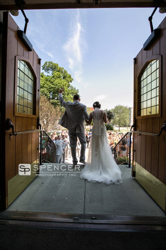 bride and groom exiting st marys church