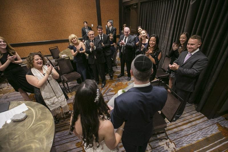 family celebrating the signing of the ketubah