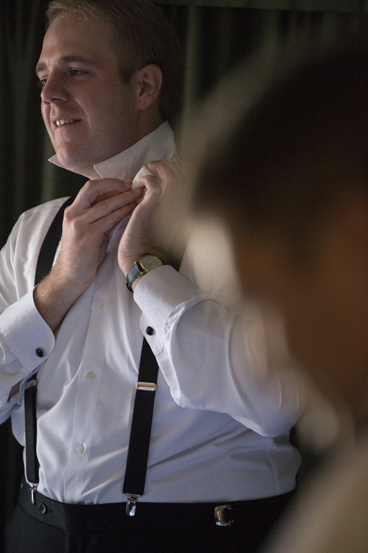 Groom preparing for his wedding at Wyndham Cleveland