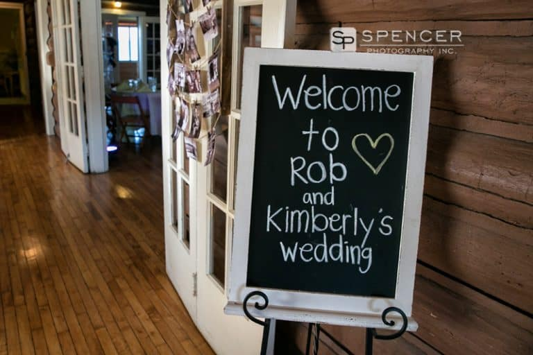 wedding reception sign at vermilion on the lake clubhouse