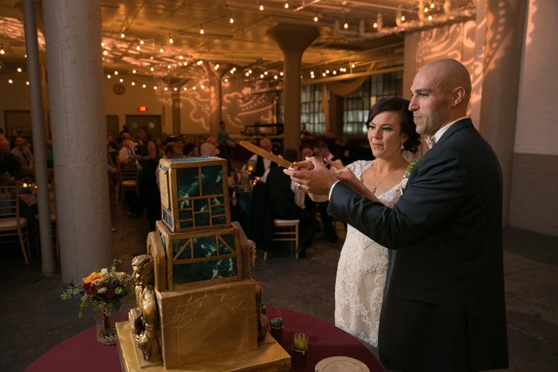 birde and groom cutting cake