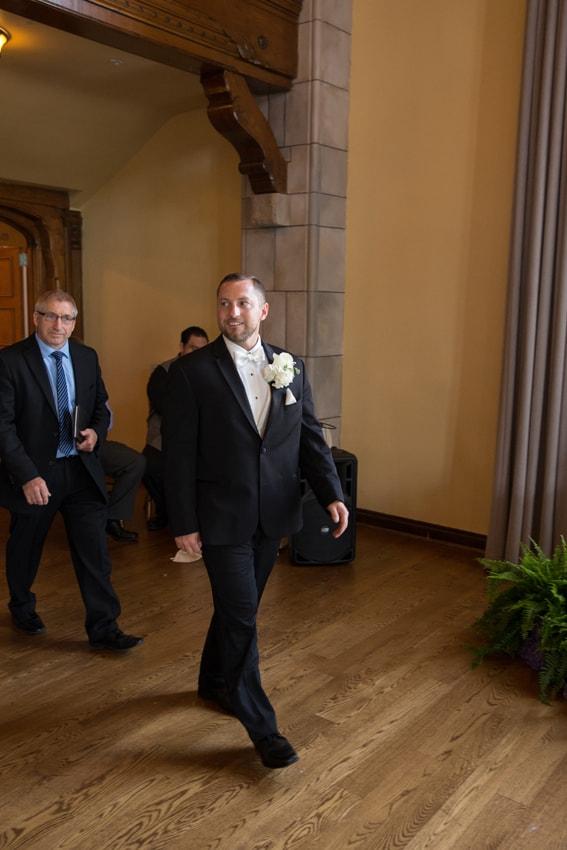 groom entering wedding ceremony