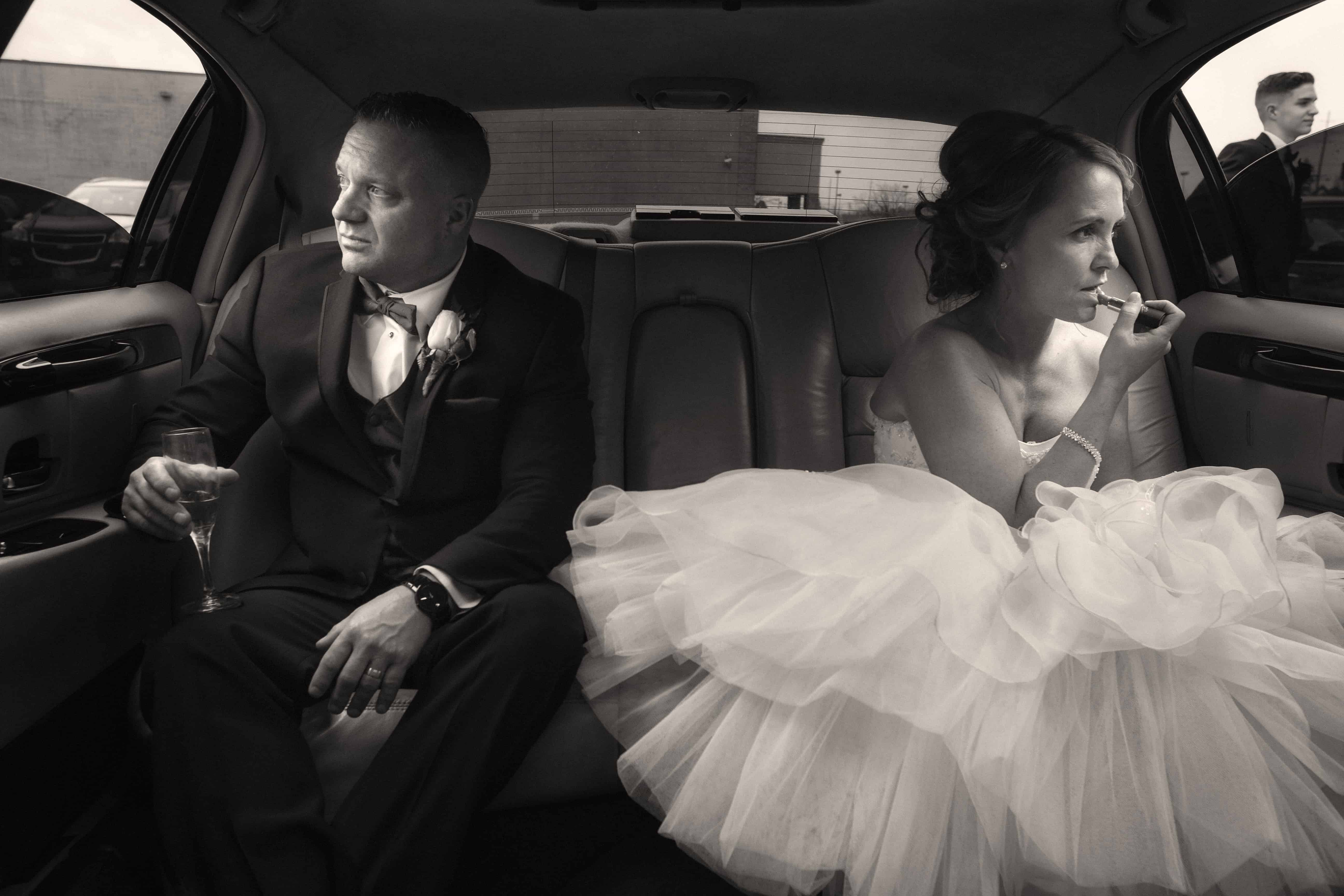 bride and groom wait to enter wedding reception at guys party center