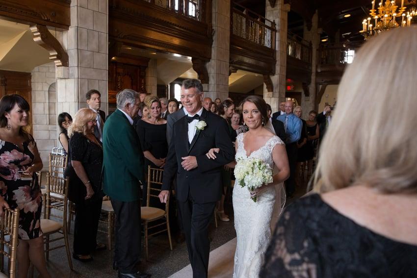 bride walking down aisle at tudor arms
