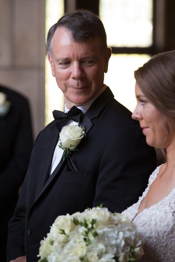 dad smiling at bride