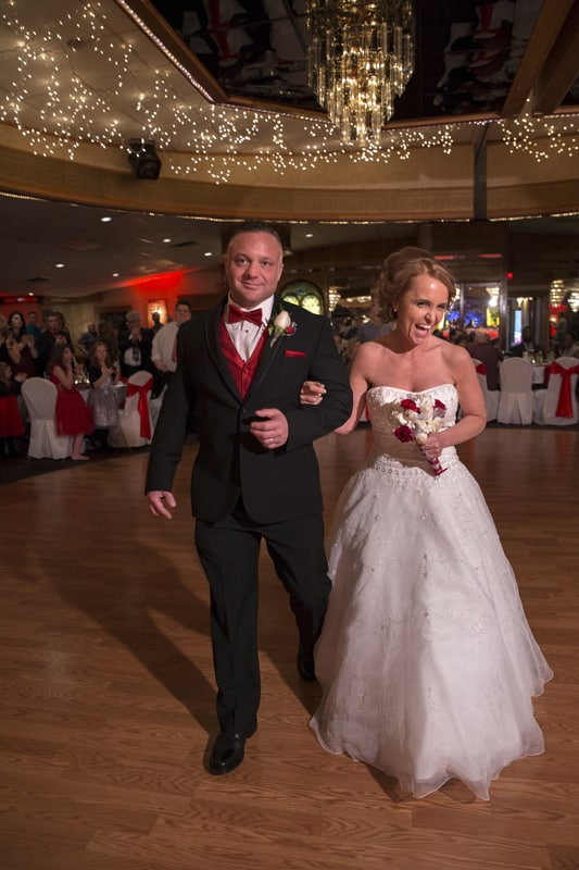 bride and groom enter reception at guys party center