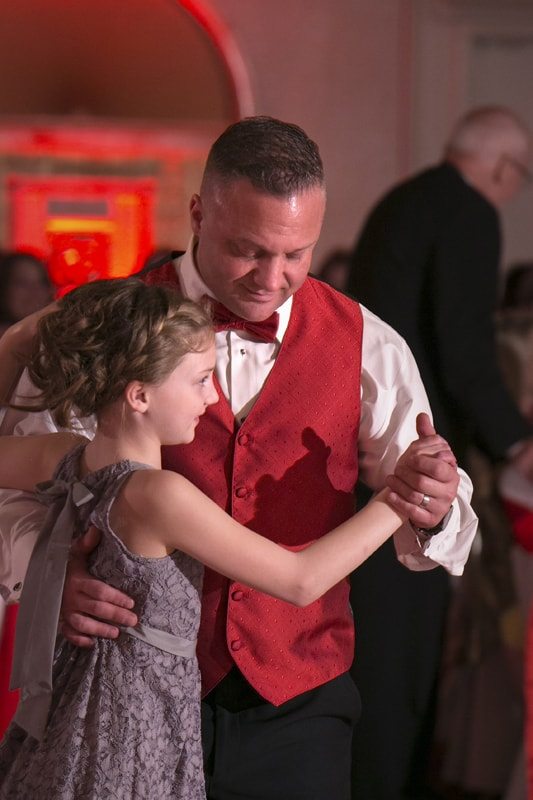 groom dancing with daughter at guys