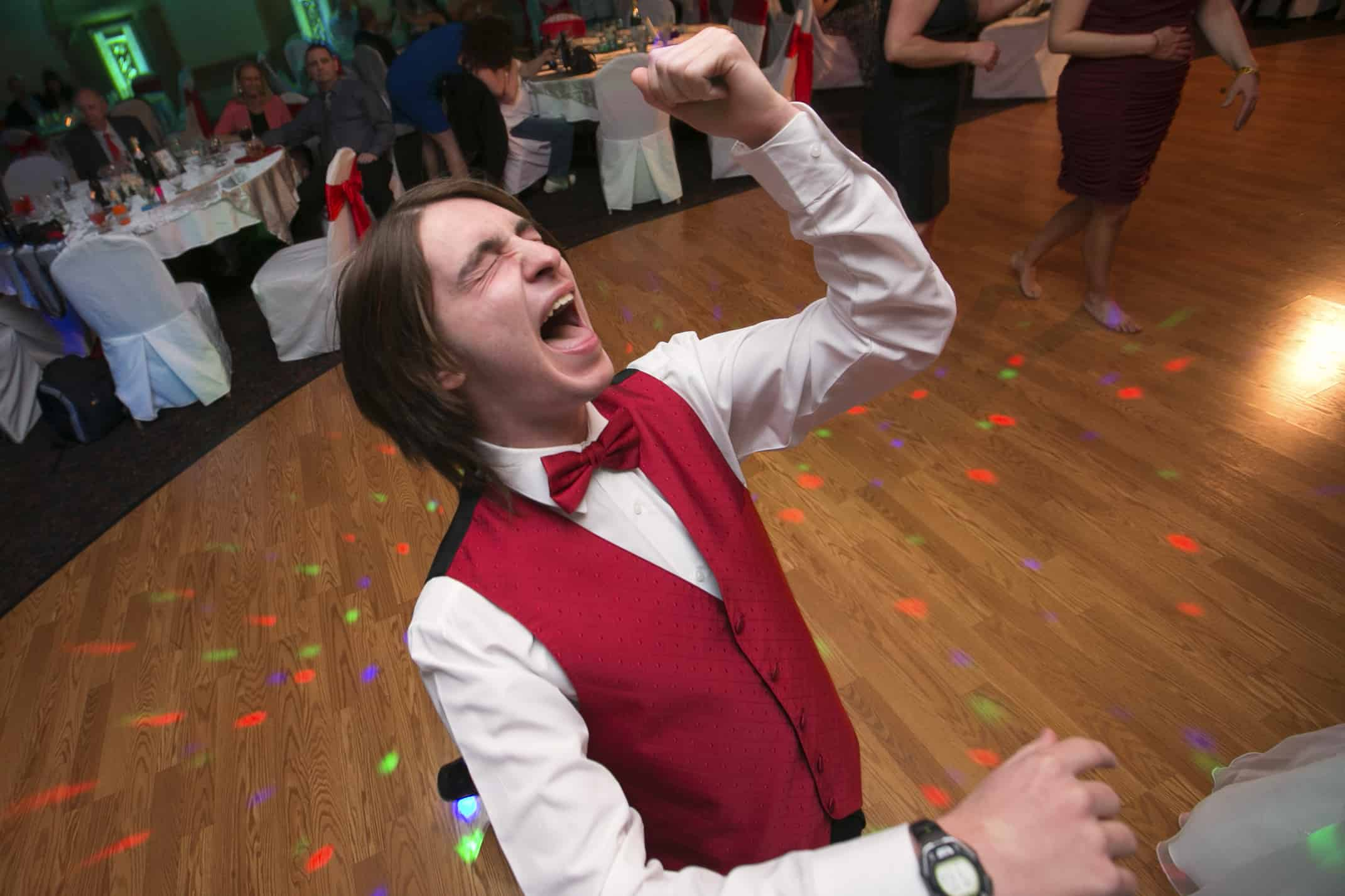 groomsmen singing at wedding reception