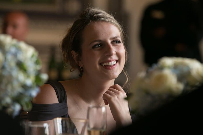 bridesmaid smiling at wedding reception