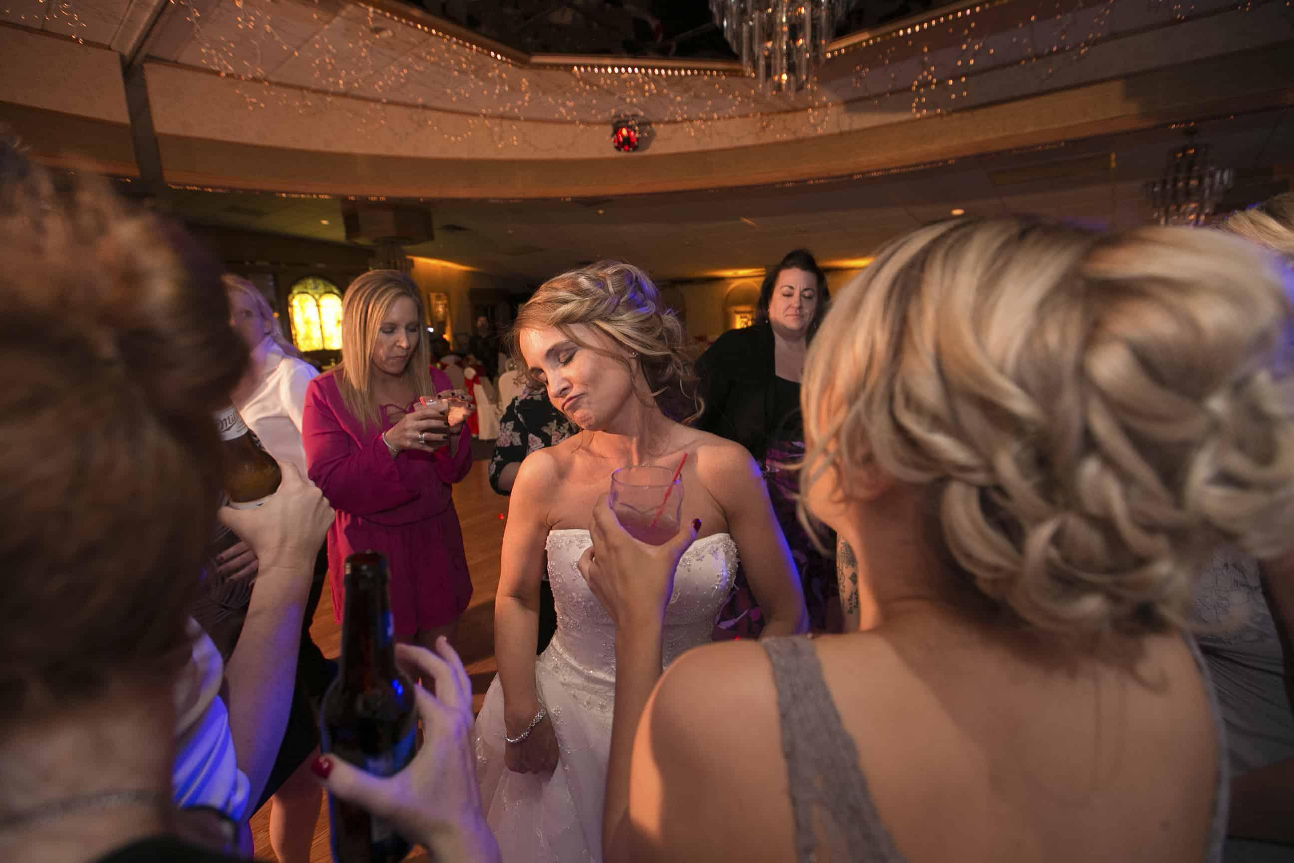 bride having fun at wedding reception Guy's Party Center
