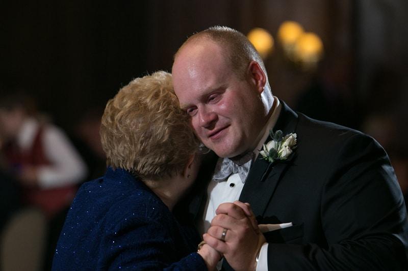 groom dancing with mom