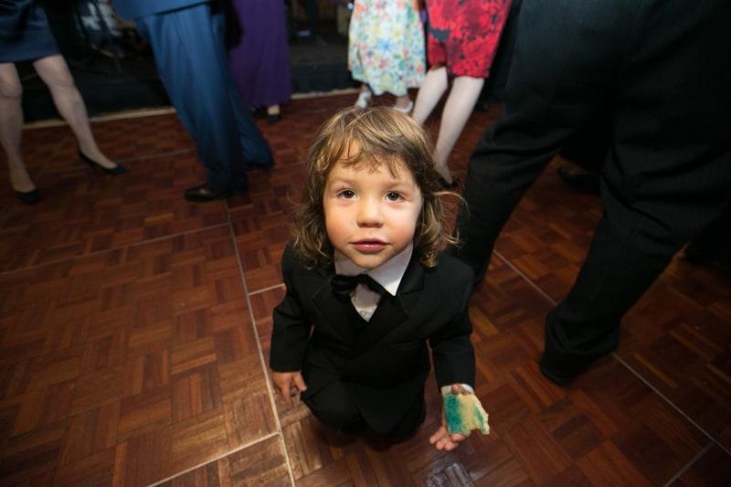 little boy at wedding reception