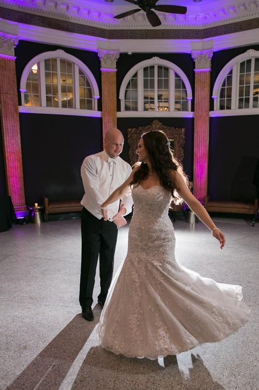bride and groom dancing at their wedding reception at ballroom at park lane