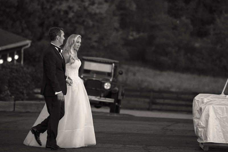 bride and groom walking to their wedding reception in copley