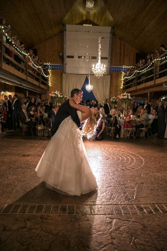 groom dips bride at wedding reception in copley