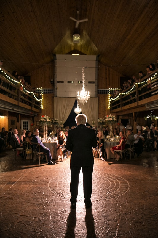 father of the bride giving wedding reception speech