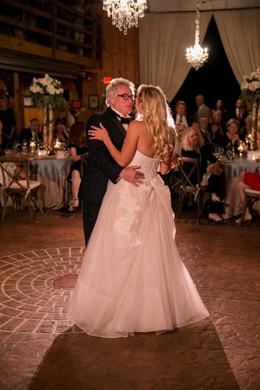 father dances with with daughter at her wedding reception in copley