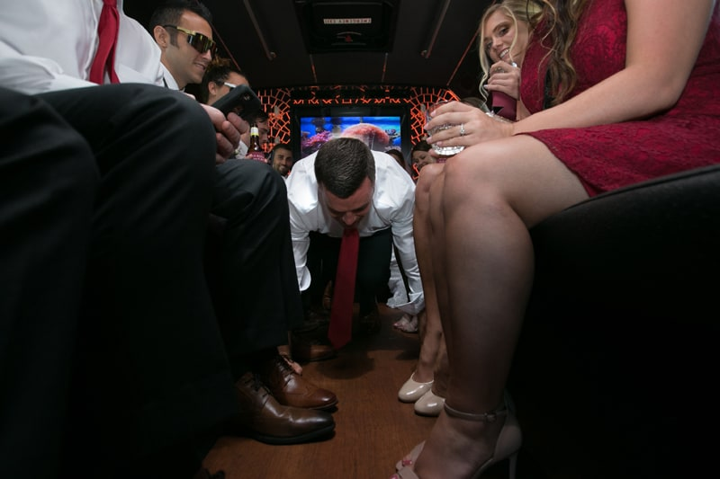 groom doing push ups on limo bus