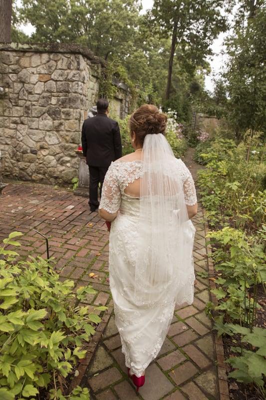 bride walking to meet groom at her wedding at stan hywet