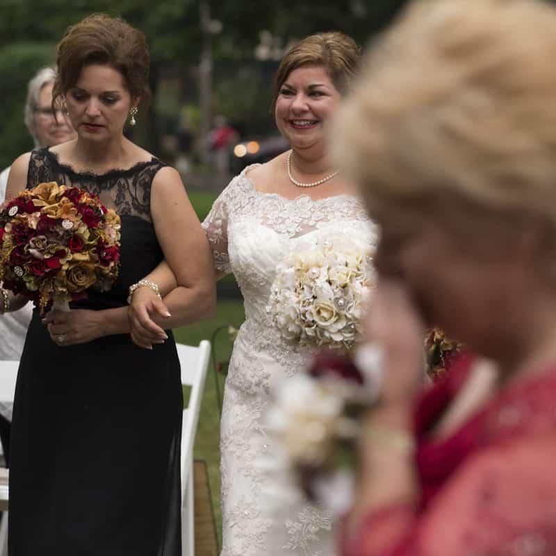 bride walking down aisle at stan hywet