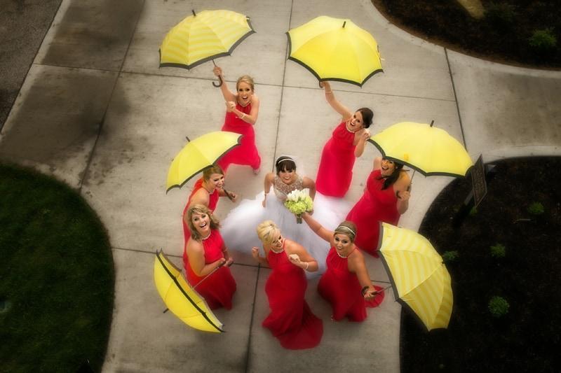 bridesmaids outside firestone with umbrellas