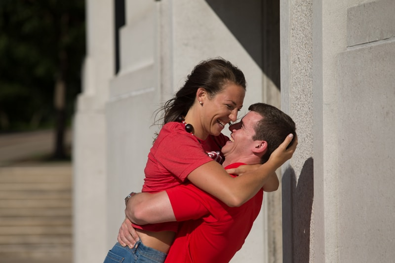 couple laughing and hugging at the shoe