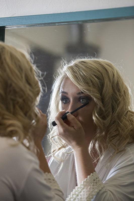 bride finishing up her make up