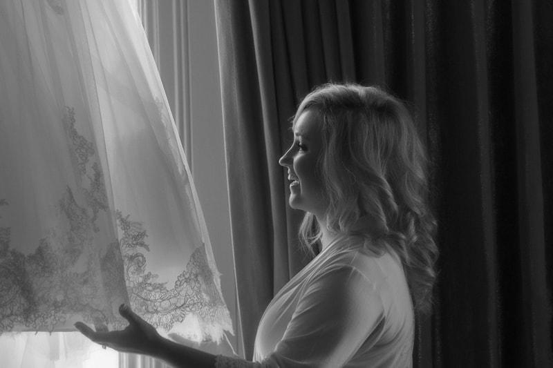 bride prepping her wedding dress