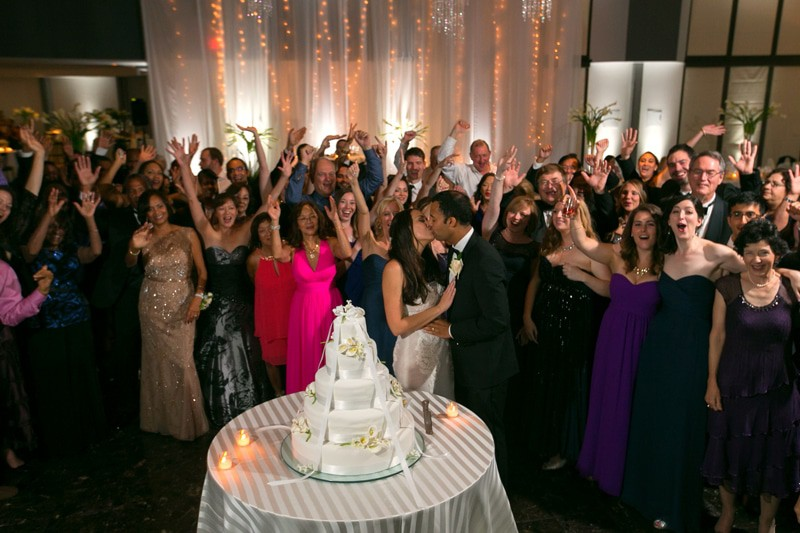 picture of wedding guest around cake at landerhaven