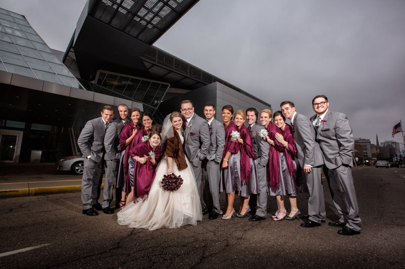 bridal party in front of akron art museum wedding reception