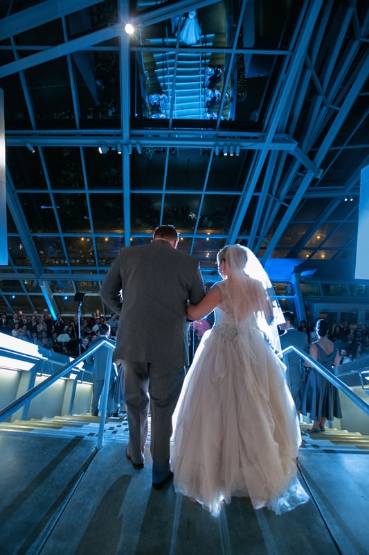bride and groom enter their wedding reception at akron art museum